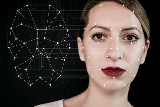 Biometric verification of a young woman with face tracking technology.