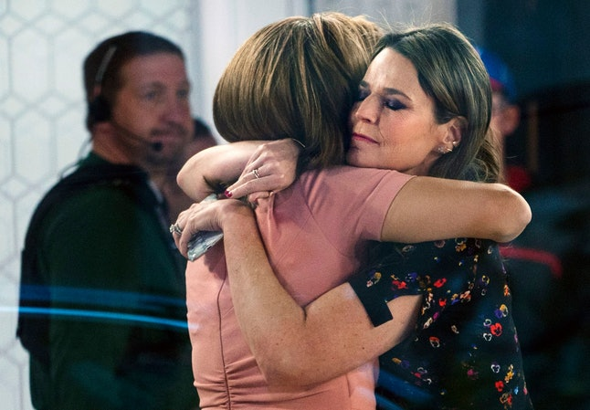 """Co-anchors Hoda Kotb, left, and Savannah Guthrie embrace on the set of the """"Today"""" show, in New York, after NBC News fired host Matt Lauer. NBC News announced Wednesday that Lauer was fired for """"inappropriate sexual behavior"""