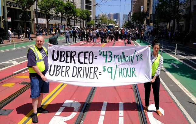Protesters stop traffic on Market Street during a demonstration outside of Uber headquarters, in San Francisco. Some drivers for ride-hailing giants Uber and Lyft turned off their apps to protest what they say are declining wages as both companies rake in billions of dollars from investors. Demonstrations in 10 U.S. cities took place Wednesday, including New York, Chicago, Los Angeles, San Francisco and Washington, D.C. The protests take place just before Uber becomes a publicly traded company Friday