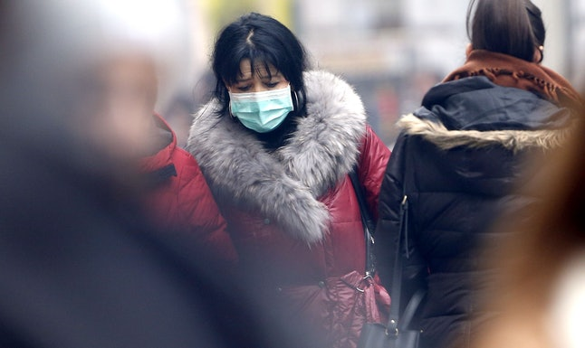 A woman walks with a protective mask  due to air pollution in Sarajevo, Bosnia and Herzegovina, 07 December 2019. According to reports, residents were recommended to reduce traffic on the roads. With 411 AQI (air quality index), Sarajevo today is one of the most polluted cities in the world.