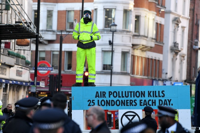 Climate activists at a protest in Cranbourn Street against high air pollution levels in London.