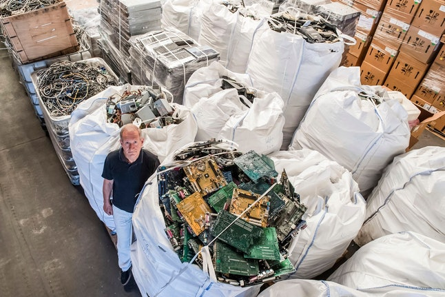 On, founder of the company, Out Of Use, Mark Adriaenssens, stands among bags of electronic parts and components to be recycled at his warehouse in Beringen, Belgium. European Union nations are expected to produce more than 12 million tons of electronic waste per year by 2020, putting the Out Of Use company at the front of an expanding market, recuperating raw materials from electronic waste