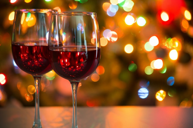 Crystal glasses of wine on the background of Christmas lights