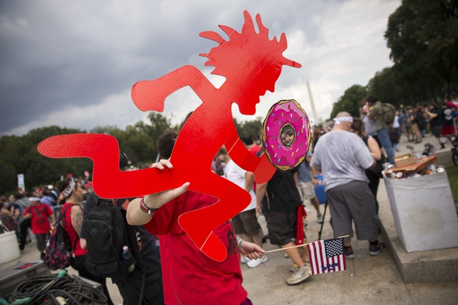 A Juggalo, fan of the band Insane Clown Posse, carries a Hatchetman with a doughnut during the Juggalo March at the Lincoln Memorial in Washington, DC, USA, 16 September 2017. The march is in protest to the FBI's National Gang Intelligence Center listing the Juggalos as a 'hybrid gang.'