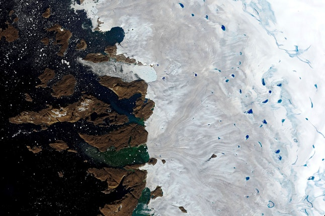This, natural-color image made with the Operational Land Imager (OLI) on the Landsat 8 satellite shows meltwater ponding on the surface of the ice sheet in northwest Greenland near the sheet's edge. While the heat wave broke in Western Europe after a few days late last month, the extreme temperatures shifted north and have caused massive ice melts in the Greenland and the Arctic, according to Ruth Mottram, a climate scientist with the Danish Meteorological Institute