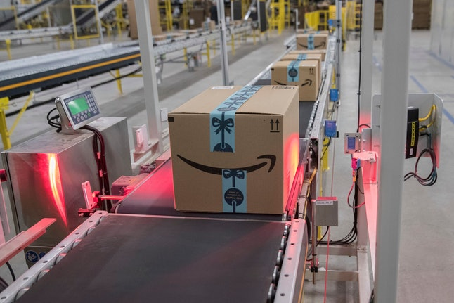 In this Dec. 5, 2018, photo a box is scanned and weighed before at the Amazon fulfillment center on Staten Island borough of New York. Amazon reports financial results