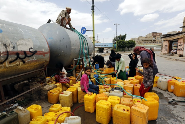 People collect clean water from a donated source in Sana'a, Yemen, 22 August 2019. According to reports, the UN has warned that it is being forced to close 22 life-saving humanitarian programmes, including clean water programmes, for 12 million people in Yemen unless significant funding is received in the coming weeks. More than four years of escalating fighting in Yemen have created the worst humanitarian crisis in the world, where some 80 percent of Yemen's 26-million population are in need of humanitarian assistance.