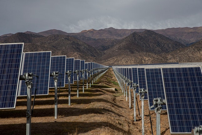 Solar panels stand in the Quilapilún photovoltaic plant, a joint venture by Chile and China, in Colina, Chile, . Chile is highlighting their alliance with China to push for a global call to reduce global warming ahead of the global climate change summit in Santiago next December