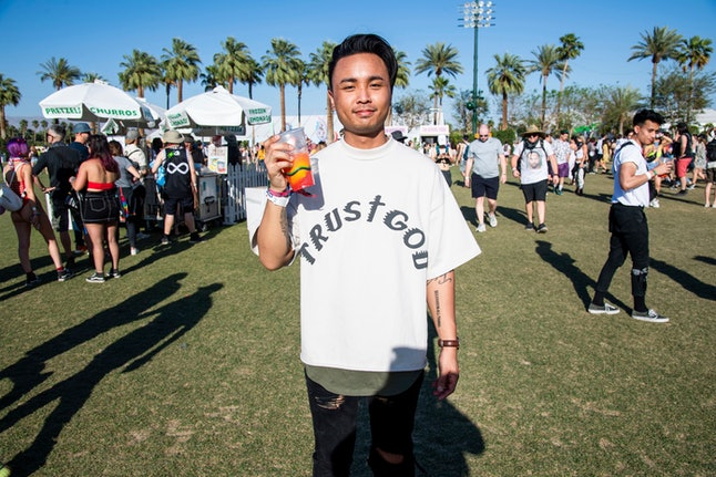A festival goers wears Kanye West Sunday Service merchandise at the Coachella Music & Arts Festival at the Empire Polo Club, in Indio, Calif
