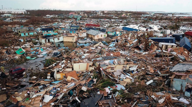 Extensive damage and destruction in the aftermath of Hurricane Dorian is seen in Abaco, Bahamas, . The storm's devastation has come into sharper focus as the death toll climbed to 20 and many people emerged from shelters to check on their homes