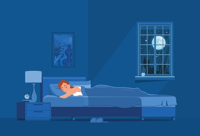 La fille dort la nuit dans son lit.