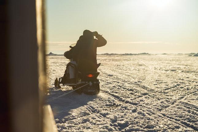A snowmobiler navigates the ice near Iqaluit, Nunavut.