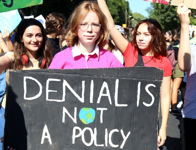 Students with a banner 'Denial is not a policy' gather for a protest against climate change in Nicosia, Cyprus, 20 September 2019. Millions of people around the world are taking part in protests demanding action on climate issues. The Global Strike For Climate is being held only days ahead of the scheduled United Nations Climate Change Summit in New York.